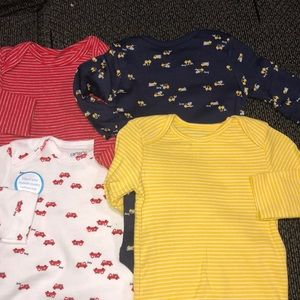 NWT 4 pieces Carters long sleeve bodysuits